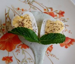 Heart shaped egg with creamy mint sauce